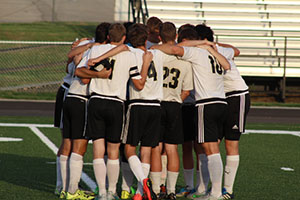 The Varsity Soccer Team has a pep talk at the home game against Baldwin on Sept 1. 2015. The game was the second game on the new turf.