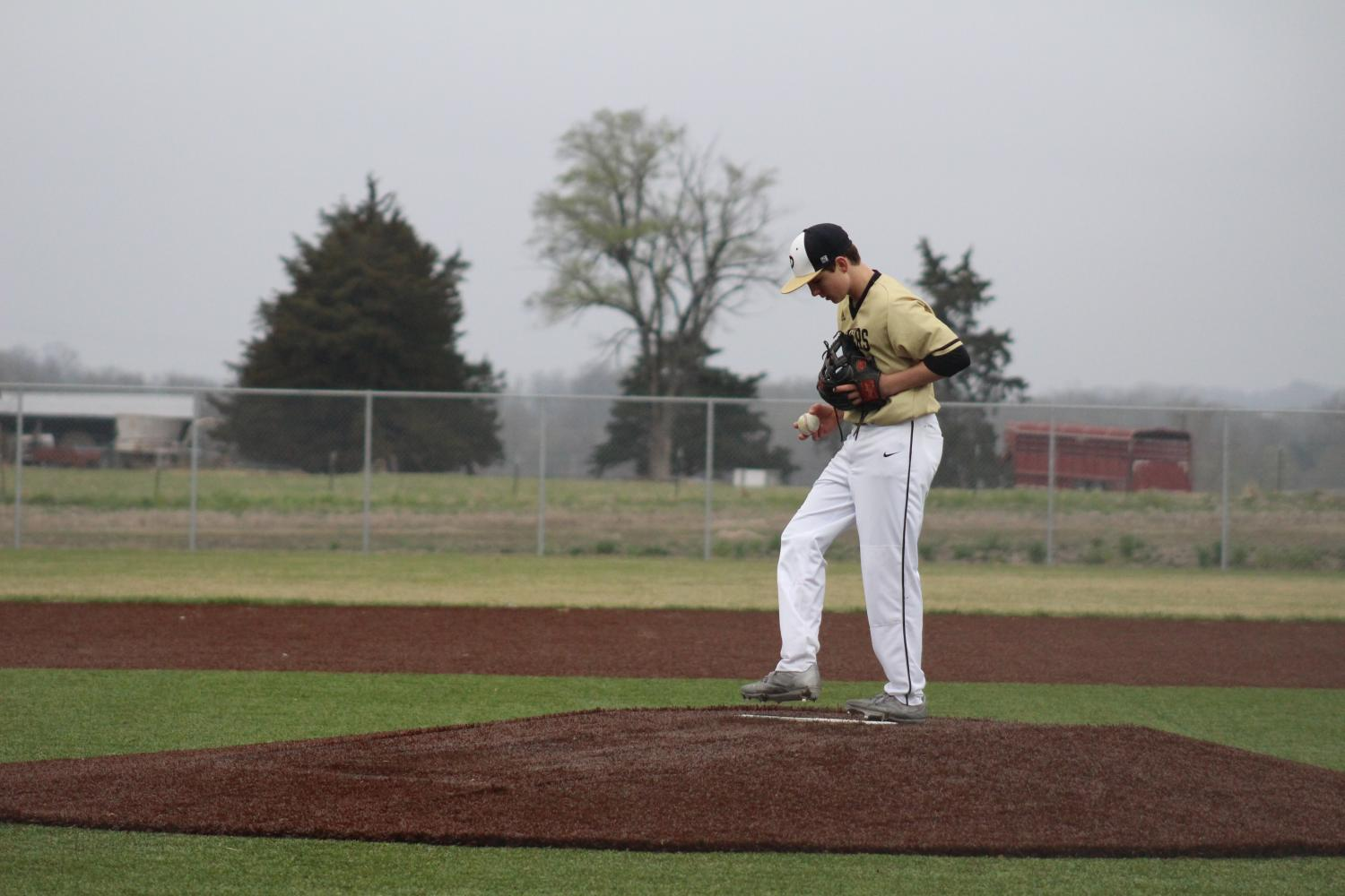 Freshman Caden Bressler steps up to the mound for the first time on varsity.