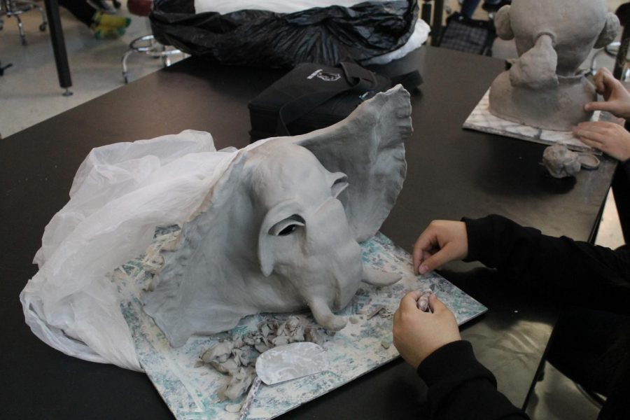 During Art 3 on Feb. 15 Hailey Statch creates her elephant sculpture.