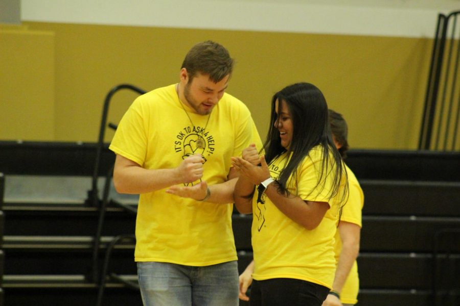 Seniors Rowan West and Miranda Carrete participate in the candidate games during the winter homecoming pep rally Feb. 7. West was crowned homecoming king later that night.