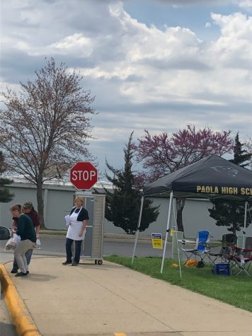 Parents drive through the high school parking lot during meal pickup provided by USD 368 for breakfast and lunch for children ages 1-18 on April 2. Food service workers enjoyed helping families in need and seeing familiar faces again, said Rita Wobker, food service worker.