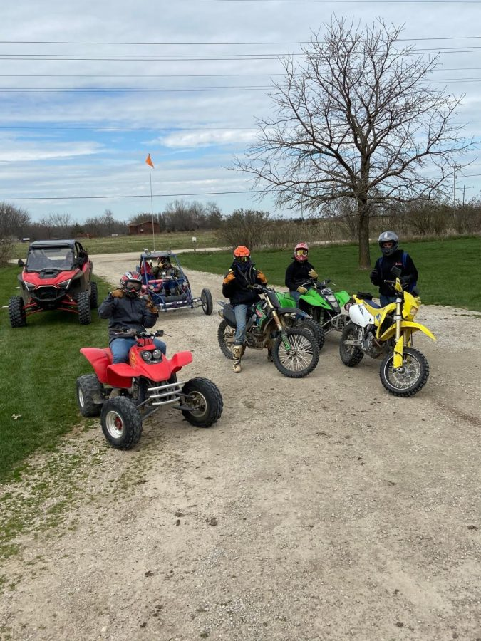 """Picture 1: Grayden Brenneman (orange helmet) rides dirt bikes with his friends on March 21, during his  quarantine. Brenneman and his friends were on a 14 day quarantine after going on a Spring Break trip. This was before the Miami County lockdown. """"Let's go ride,"""" said Brenneman. [Photo by Hannah Billesbach]   Picture 2: Leyton Wheeler, Grayden Brenneman, Noah Bowden, Evan Peuser, Javi Castillo and Jordan Billesbach, seniors, went to Pensacola, Florida, for their spring break and senior trip. """"It was fun, but I am glad to be home,"""" said Billesbach. [Picture credits from Kim Billesbach]  Picture 3: Grayden Brenneman gets off work after helping his dad with construction on April 2. He plans to help run a business this fall after he graduates. After his 12 hour shift he then has to go to his other job at Family Center.  [Photo by Hannah Billesbach]"""