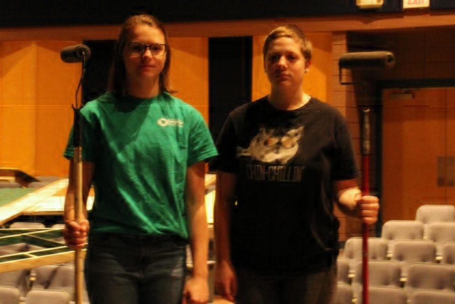 Senior Kaitlyn White, left, and junior Raye Nolte paint the set of Godspell, which the PHS theater department performed in November. White loves theater and plans to major in it in college.