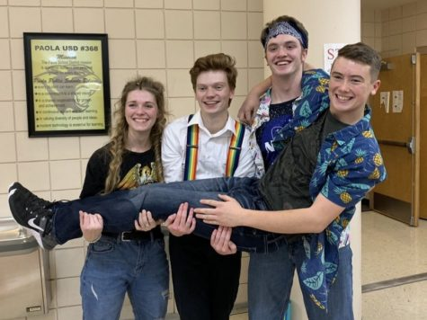Freshman Layne Anderson felt supported by senior Jacob Farmer, second from left, as a freshman. Seniors Ashley Schwach, left and Creighton Markovich hold Anderson up after the production of Godspell this fall.