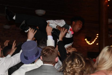 Jovanni Blackie, junior, crowd surfs during Prom at Town Square April 24.